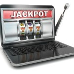 Jackpot. Online gambling concept. Laptop slot machine.